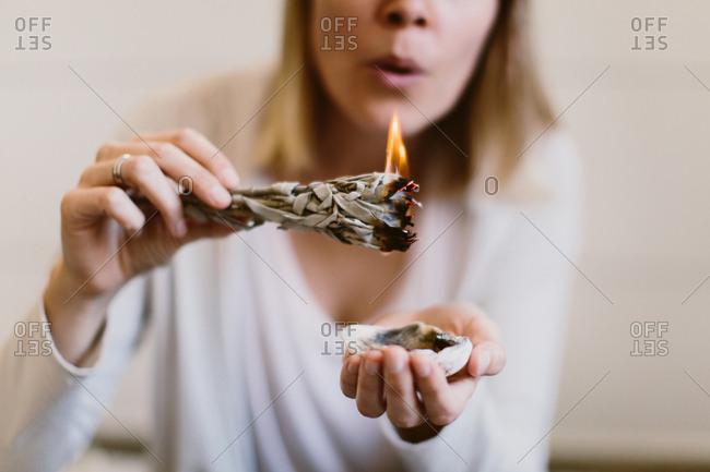 Woman burning sage