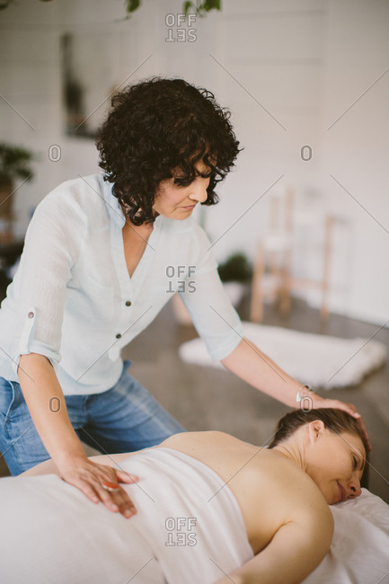 Woman on a massage table with masseuse