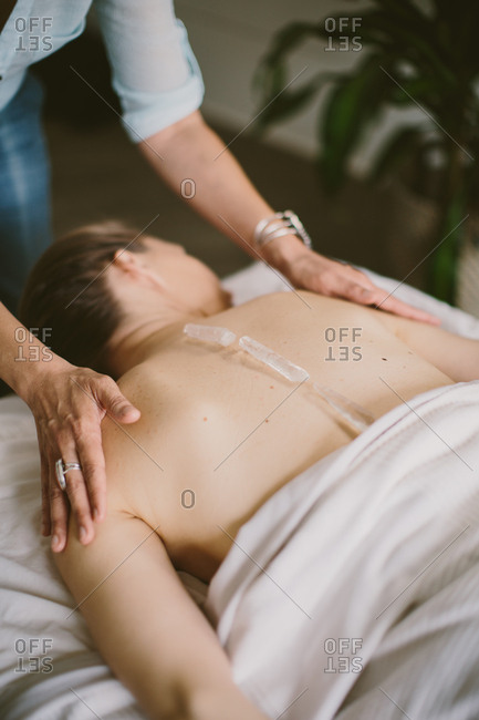 Massage with crystals  on back