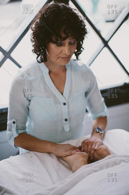 Masseuse giving a foot massage
