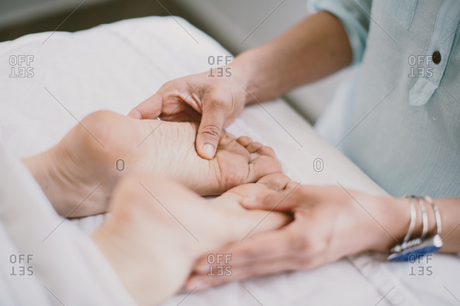Masseuse giving a foot massage