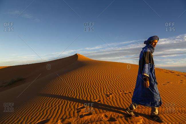 Merzouga, Morocco - November 24, 2016: Tuareg man at the Erg Chebbi sand dunes, Sahara Desert