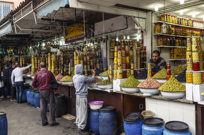 Marrakesh, Morocco - November 29, 2016: Stalls selling olives in the market