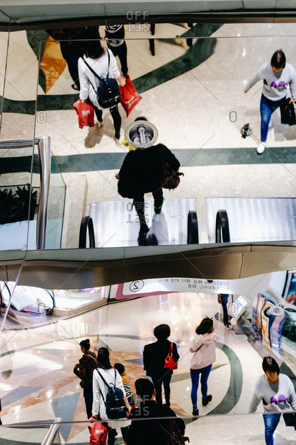 Guangzhou, China. - March 19, 2017: People crowd in marketplace