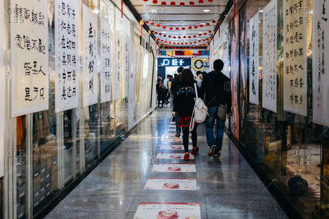 Guangzhou, China. - March 19, 2017: Chinese Script Writing in street