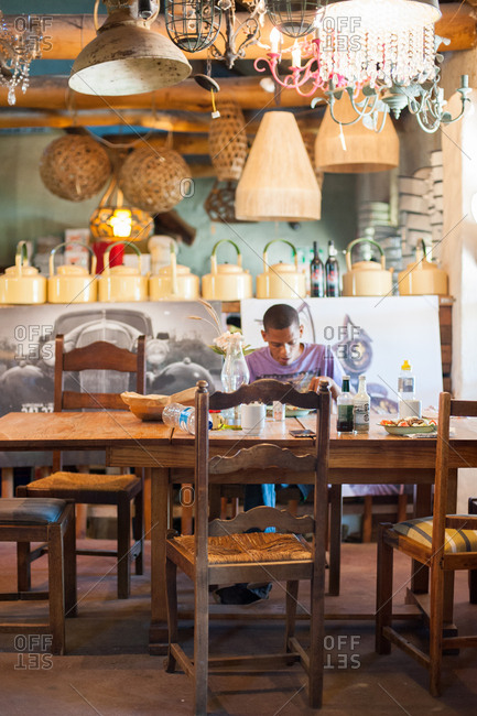 Caledon, South Africa - July 22, 2015: Man sitting at table eating in a restaurant