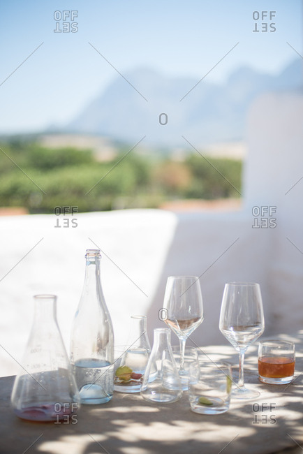 Empty wine glasses on an outdoor table