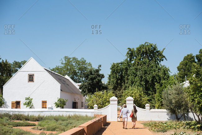 Stellenbosch, South Africa - July 22, 2015: Tourists exploring a wine estate in South Africa