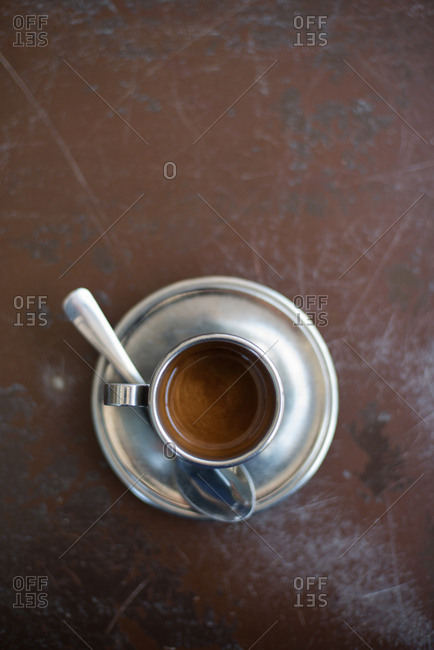 Shot of espresso served in a silver mug