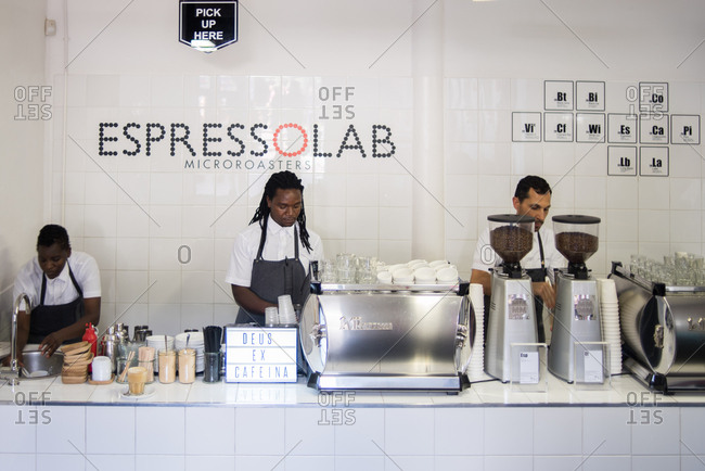 Cape Town, South Africa - January 12, 2017: Male baristas working in an espresso shop