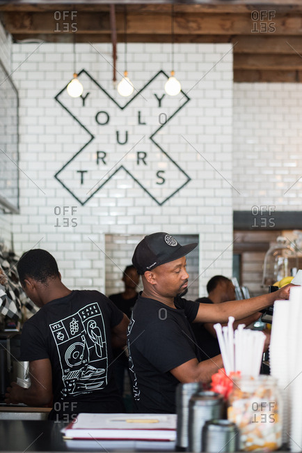 Cape Town, South Africa - February 1, 2017: Baristas working in a coffee shop in Cape Town, South Africa