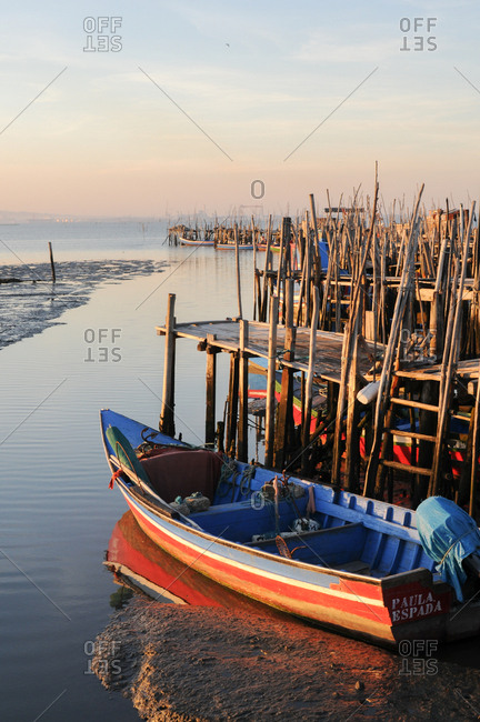 Carrasqueira, Comporta, Portugal - July 22, 2015: Marina with stilt docks and boats in Portugal