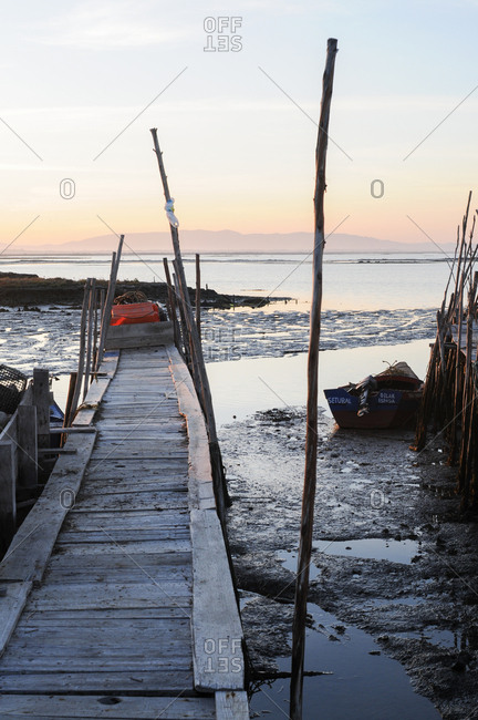 Carrasqueira, Comporta, Portugal - July 22, 2015: Harbor with stilt docks and boats in Portugal