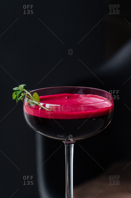 Dark red cocktail in a coupe glass