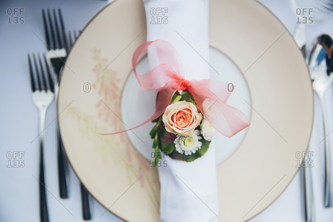 Overhead view of decorated napkin on a wedding plate