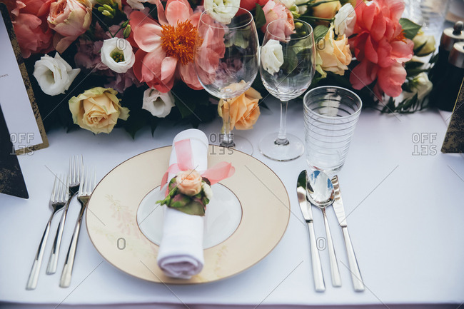 Place setting with floral centerpiece at a wedding table