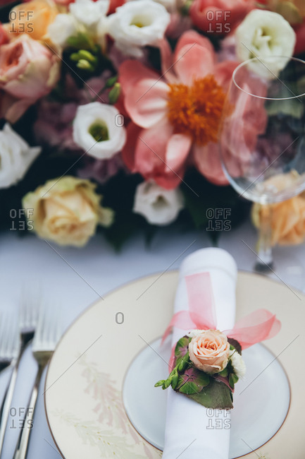 Floral decoration on a napkin on a wedding plate