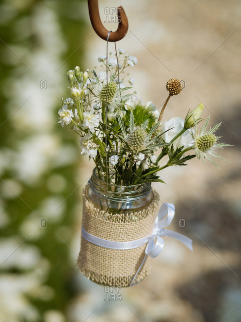 Rustic floral wedding decoration wrapped in burlap