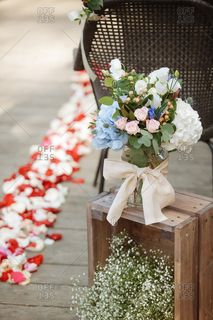 Floral arrangement on a wooden crate at a wedding