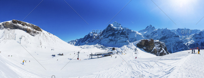 Canton of Bern, Switzerland - February 25, 2017: View from First to Schreckhorn and Wetterhorn and ski slope in Grindelwald