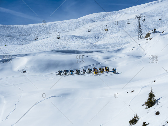 Canton of Bern, Switzerland - February 26, 2017: Snow cannons and chair lift at a Grindelwald ski area