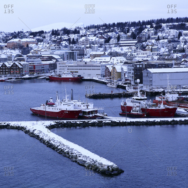 Tromso, Norway - February 23, 2010: A winter view of ships at the harbor coast