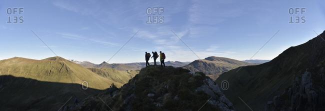 UK- North Wales- Snowdonia- Nantlle Ridge- silhouette of three mountaineers