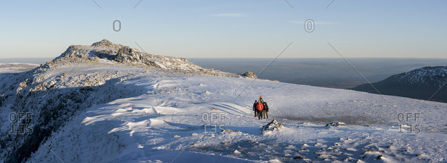 UK- North Wales- Snowdonia- Ogwen- Glyder Fawr- mountaineers on snow area