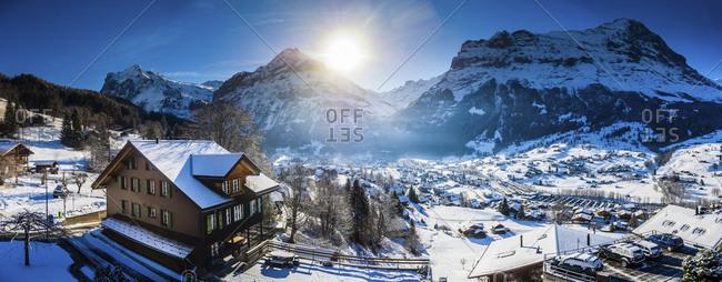 Switzerland- Canton of Bern- Grindelwald- townscape in winter at sunrise with Maettenberg- Mittelhorn and Wetterhorn