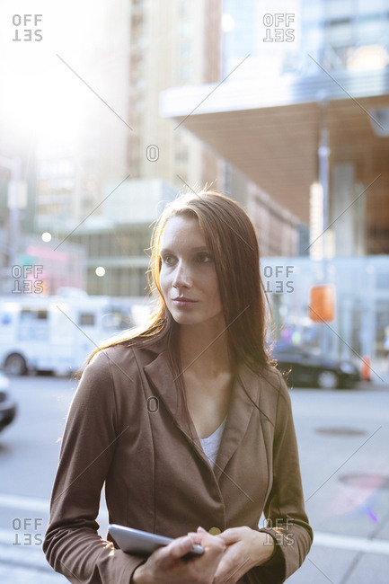USA- New York- Manhattan- portrait of serious young businesswoman with tablet