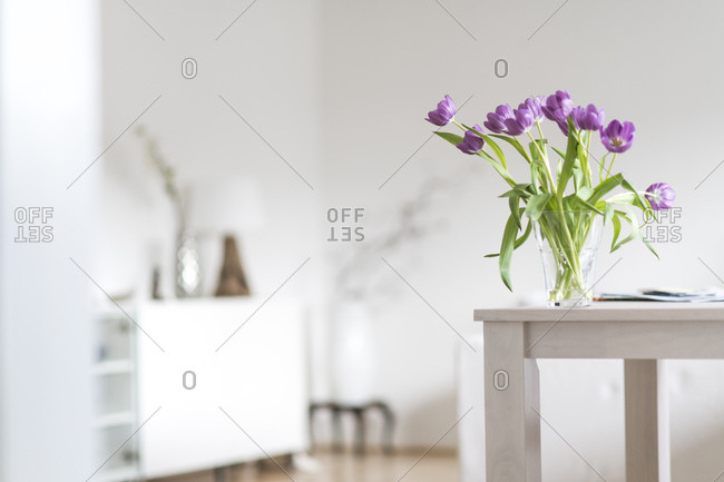 Bunch of tulips on table at home