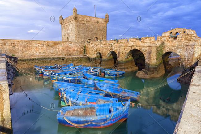 Morocco- Essaouira- blue fishing boats in the harbor