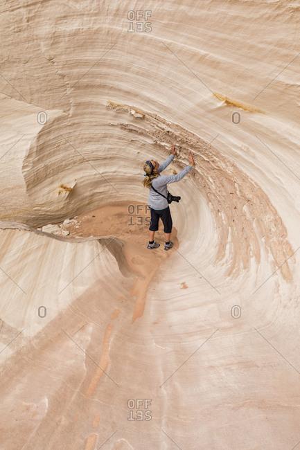 USA- Paria Canyon- Vermillion Cliffs- Page- tourist inside rock formation Nautilus