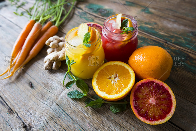 Juice with oranges and ginger and mint and carrots