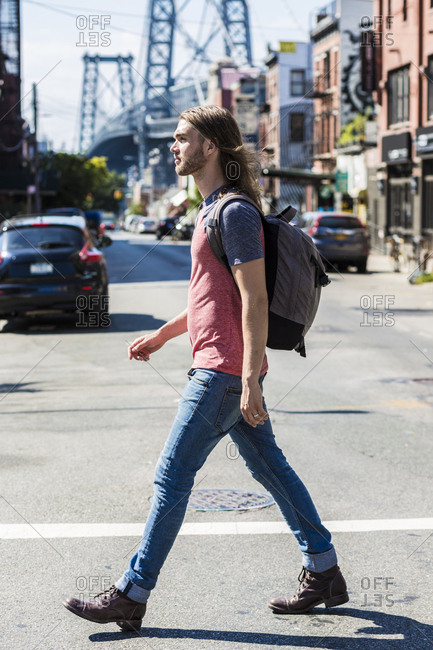 USA- New York City- man crossing the street in Williamsburg- Brooklyn