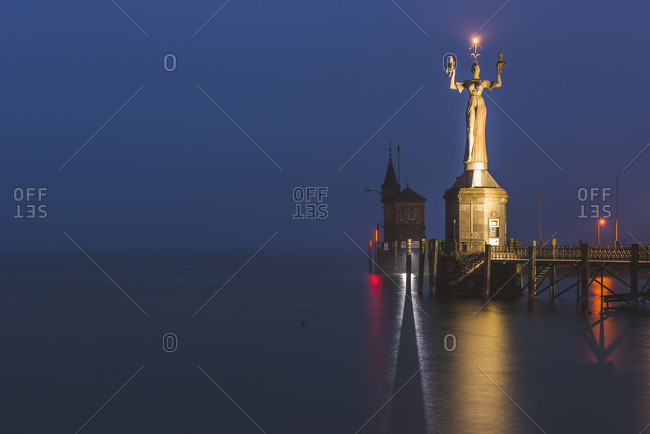 Germany- Baden-Wuerttemberg- Constance- harbor entrance with Statue Imperia in early morning