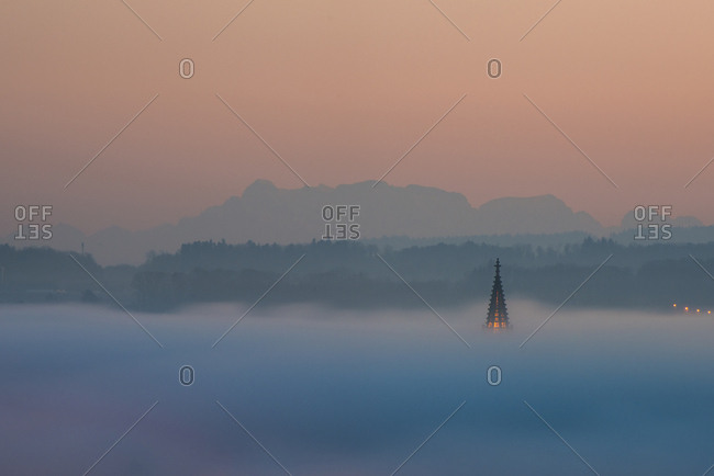 Germany- Constance- spire of Constance minster emerging from sea of fog
