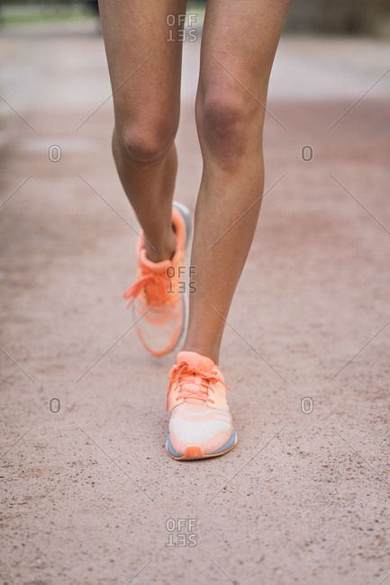 Close-up of running woman