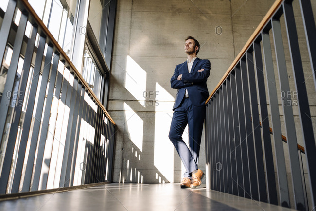 Businessman standing in staircase