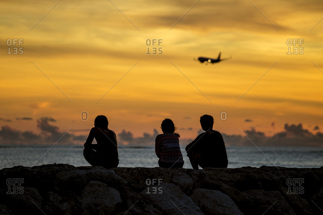 Indonesia- Bali- people watching the sunset over the ocean