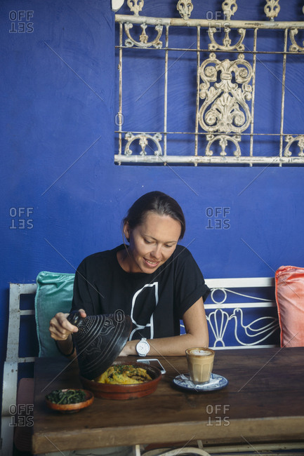 Indonesia- woman looking at dish in a cafe