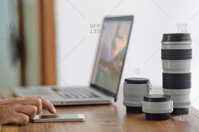Photographer working on desk at home