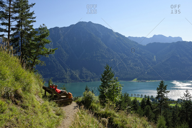 Austria- Tyrol- Rofan Mountains- hiker relaxing on a lounge