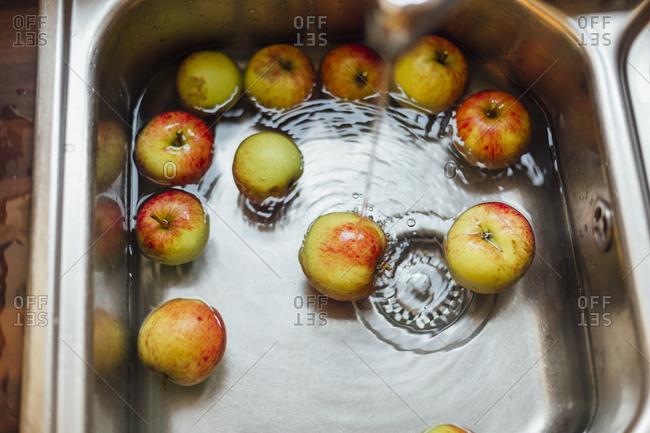 Washing apples in sink