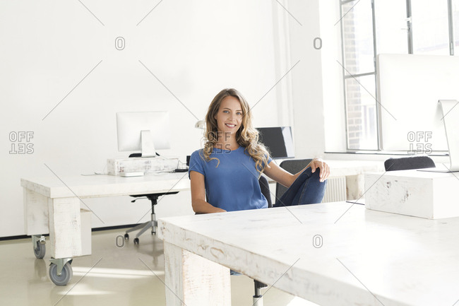 Casual businesswoman sitting in office
