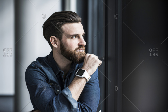 Portrait of a young businessman wearing smart watch