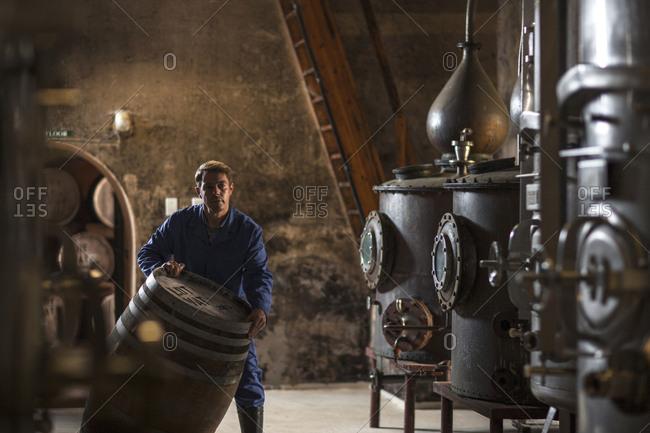 Worker working in distillery