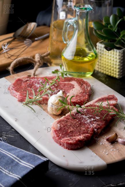 Raw steak with seasonings