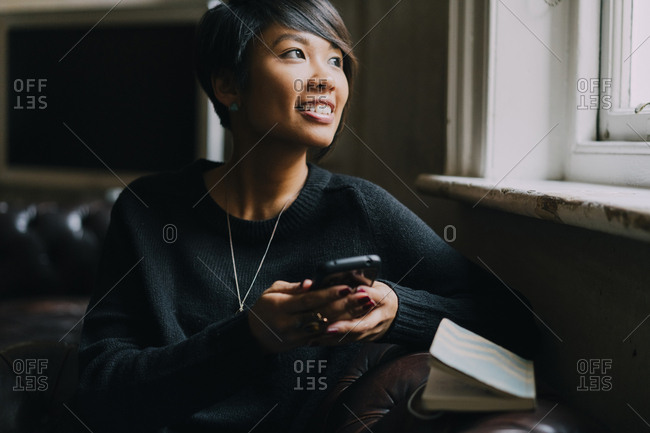 Young businesswoman on the phone working from home