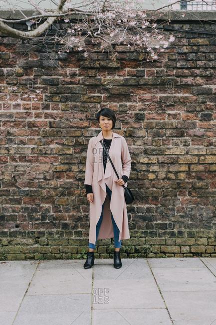 Young beautiful Asian woman walking in the park